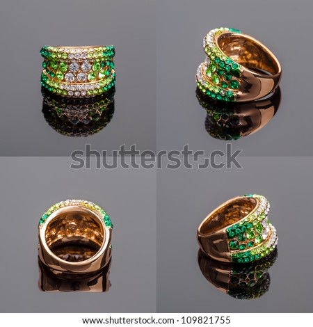 Gold ring with green crystals on on all sides - stock photo
