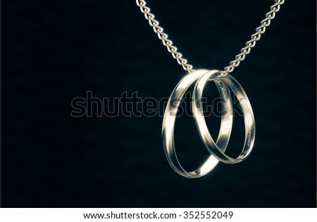 Gold rings and necklaces focus light 3d rendering. - stock photo
