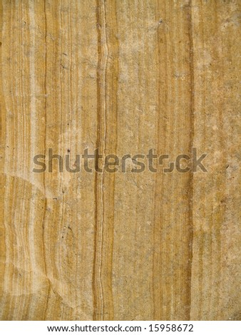 Gold rock texture shot close-up which can be use as background. - stock photo