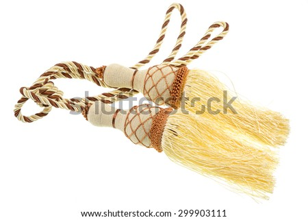 Gold rope with tassel isolated on white background.  - stock photo
