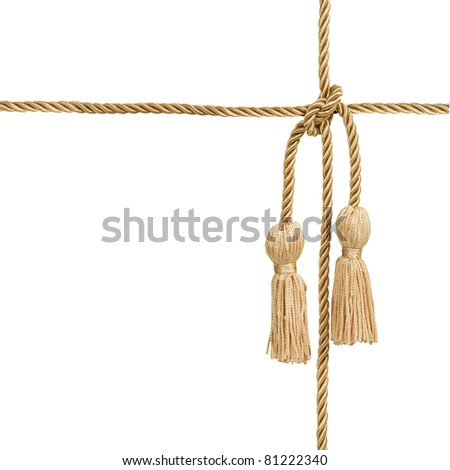 Gold rope with tassel isolated on white (with clipping patch) - stock photo