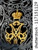 gold russian imperial family crown on Hermitage gates - stock photo