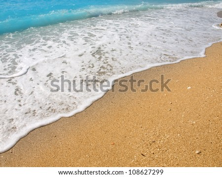 Gold sand and blue water - stock photo