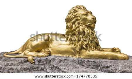 Gold Sculpture statue of a lion - stock photo