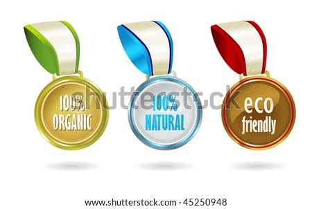 Gold, silver and bronze medals featuring organic, bio-friendly messages. - stock photo