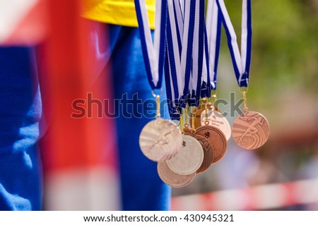 Gold, silver and bronze metal in the air. Nice background for Rio olympic time - stock photo