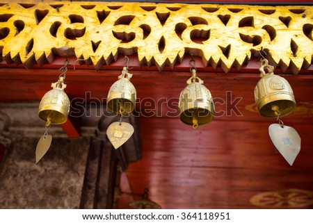 Gold small bell from a temple in Thailand - stock photo