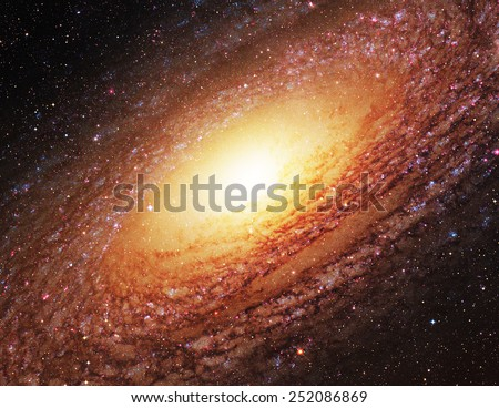 Gold Spiral Galaxy - Elements of this Image Furnished by NASA - stock photo