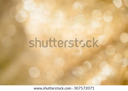 Gold spring or summer background with bokeh defocused lights - stock photo