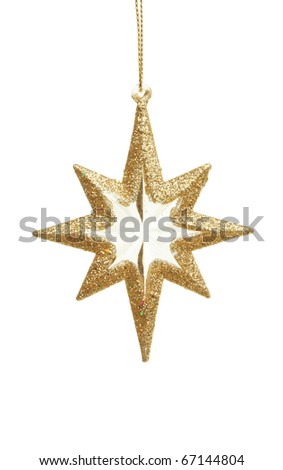 Gold star Christmas ornament isolated against white - stock photo