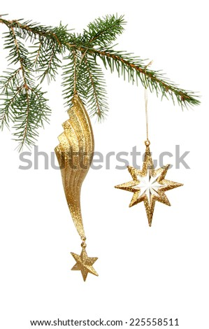 Gold star Christmas ornaments hanging in a tree against a white background - stock photo