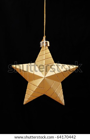 Gold star on black background, Christmas image - stock photo