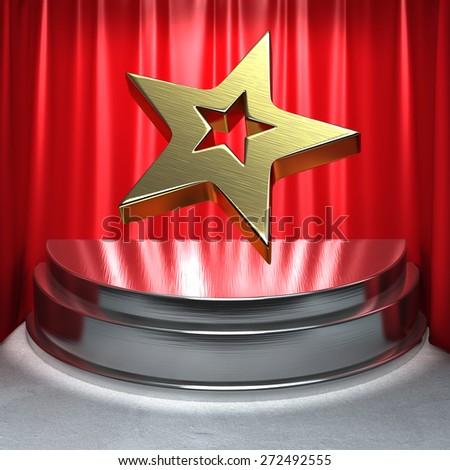 Gold Star On Chrome Pedestal - stock photo