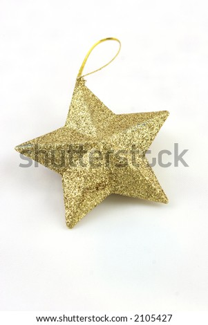 Gold star shaped Christmas decoration on a white background - stock photo