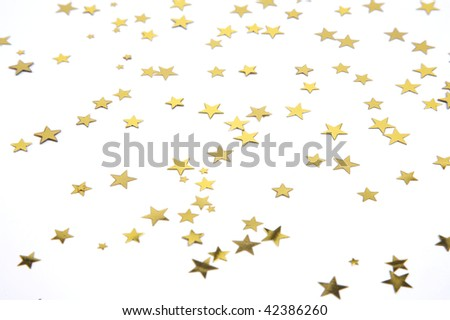 Gold stars on a white background, selective focus