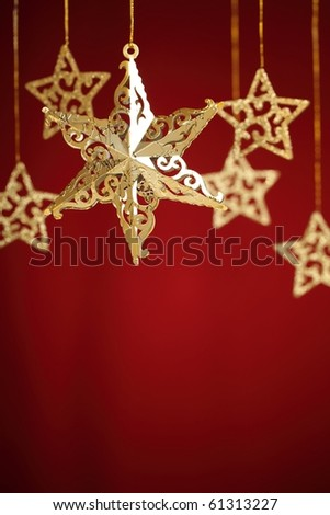 Gold stars  over red background,Shallow Dof. - stock photo