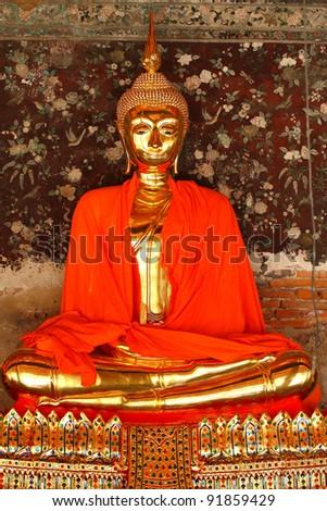 Gold statue Buddha and red blanket at Wat Rachanutda in Bangkok, Thailand. - stock photo