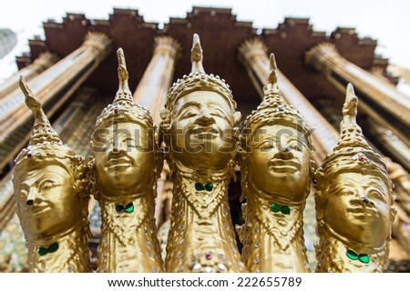 Gold Statue From Wat Phra Kaeo In The Grand Palace In Bangkok, Thailand