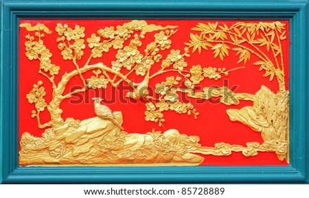 gold stucco design of native chinese style on the Wall - stock photo