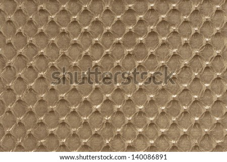 Gold synthetic leather with embossed texture background - stock photo