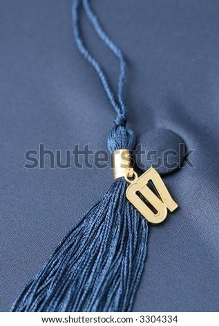Gold '07 tassel on background of blue graduation cap.  Shallow depth of field - stock photo