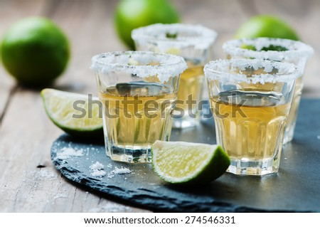 Gold tequila with lime and salt, selective focus - stock photo