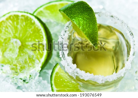gold tequila with salt and lime on a ice. - stock photo