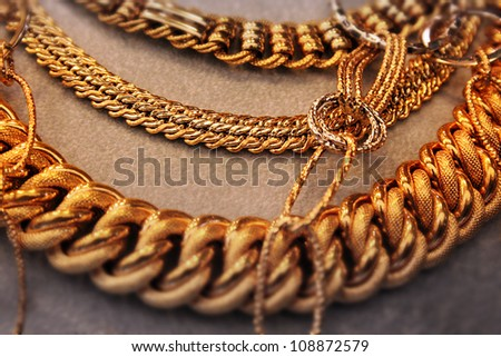 Gold thick necklace jewelry - stock photo