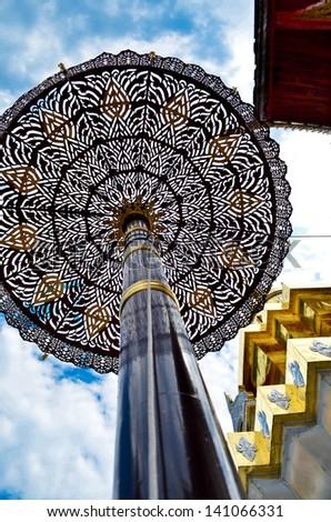 Gold tiered umbrella around pagoda temple chiangmai Thailand - stock photo