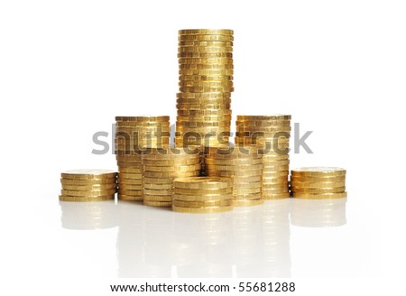 Gold towers made out of gold coins - stock photo