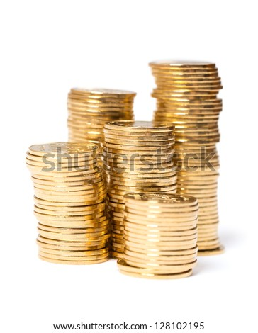 Gold towers made out of gold coins on a white - stock photo