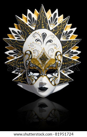 Gold traditional venetian carnival mask isolated on black. Venice, Italy. - stock photo