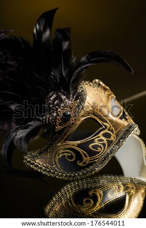 Gold traditional venetian carnival mask. Venice, Italy. - stock photo