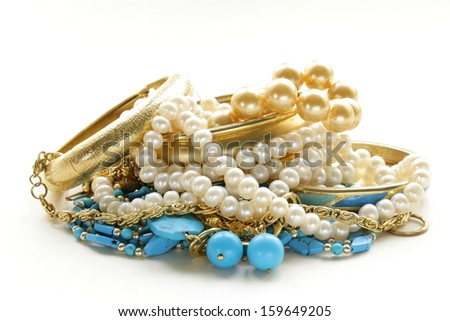 gold, turquoise jewelry and pearl,  on a white background - stock photo