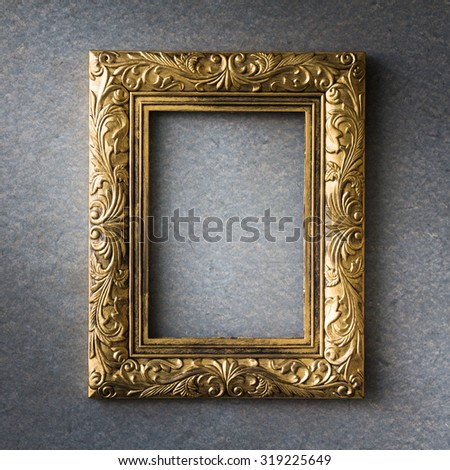 Gold vintage photo frame over gray grunge background, Still life style