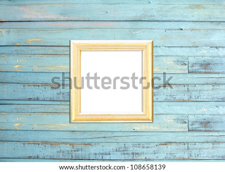 Gold Vintage picture frame, wood plated, blue wood background, clipping path included - stock photo