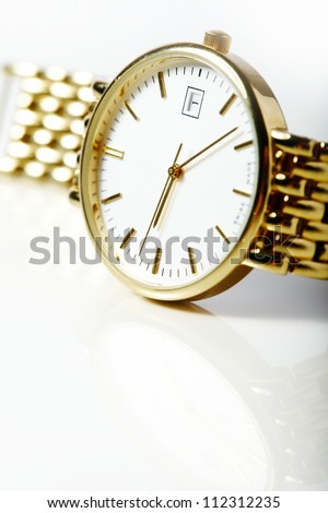 Gold watch isolated on white background