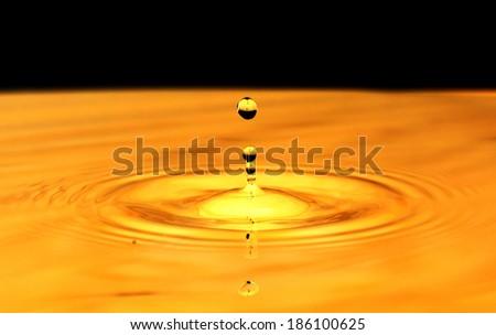 Gold water drop - stock photo