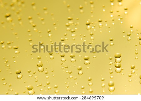 Gold water drops on mirror background