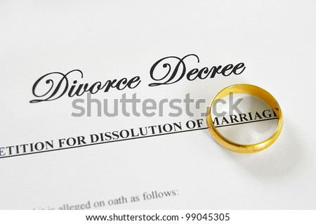 gold wedding ring on a divorce decree - stock photo