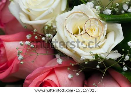 Gold wedding rings on flower . Decorating the wedding ceremony.  - stock photo