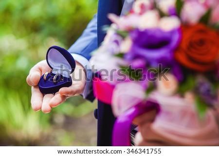 gold wedding rings on the pincushion - stock photo