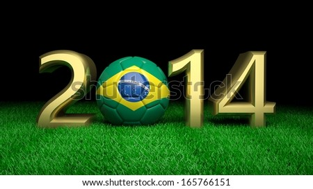 Gold 2014 with Brazilian soccer ball on grass - stock photo