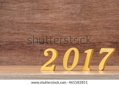gold wooden font of year 2017 on wood table