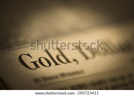 Gold written newspaper, shallow dof, real newspaper. - stock photo