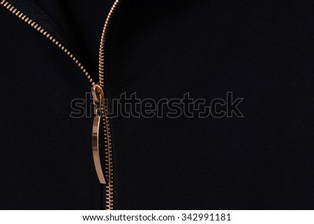 gold zipper opened on a black background