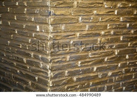 Goldbarren background. brick wall for designer