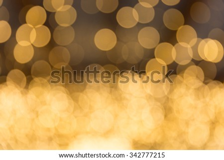 Golden abstract background with bokeh defocused lights