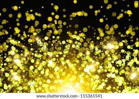 Golden abstract background with bokeh effect - stock photo