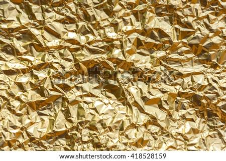 Golden Aluminium foil texture - stock photo
